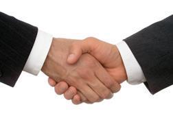 merger shaking hands men