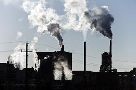 Industrial chimneys smoking with pollution
