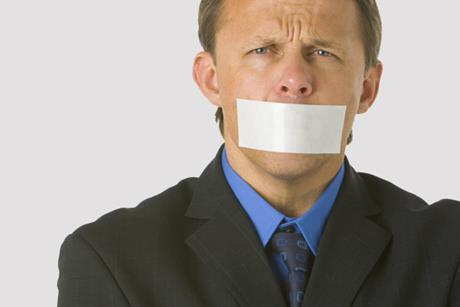 A man with tape over his mouth