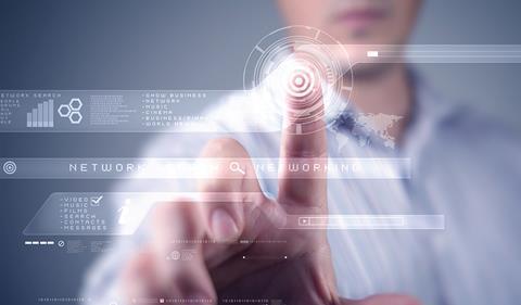 A mans hand pressing a futuristic computer screen