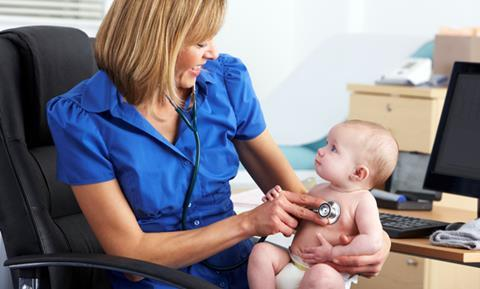 Woman GP with a baby