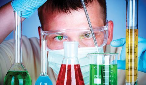 Man lookng closely at research chemicals