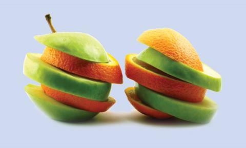 Sliced apples and oranges interspliced with each other