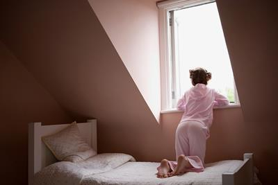 mental health child depressed looking out window alone bed