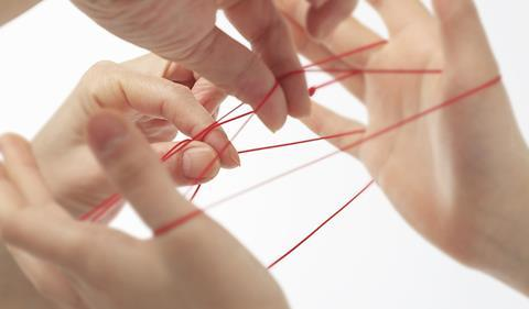 Cats cradle played by two people