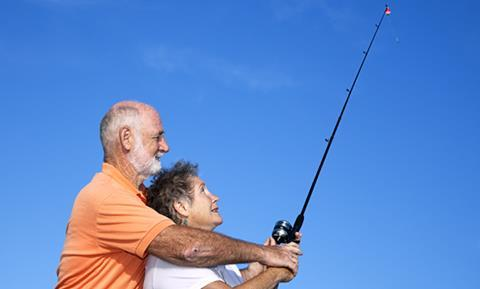 Older man and woman fishing