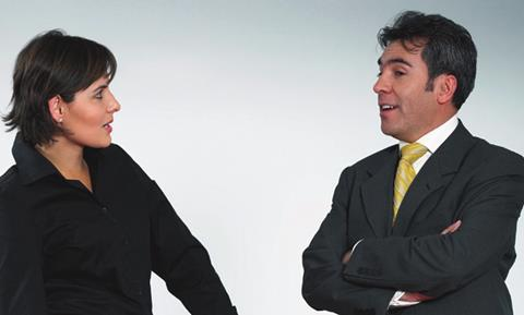 Woman and man talking business