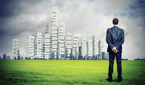 Businessman looking at city skyline which includes leadersip phrases such as