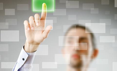 A man pressing a green spot on glass. Conceotual technology image