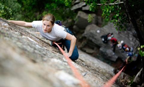 A woman climbing a rockface