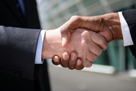 Merging trusts target £20m annual savings